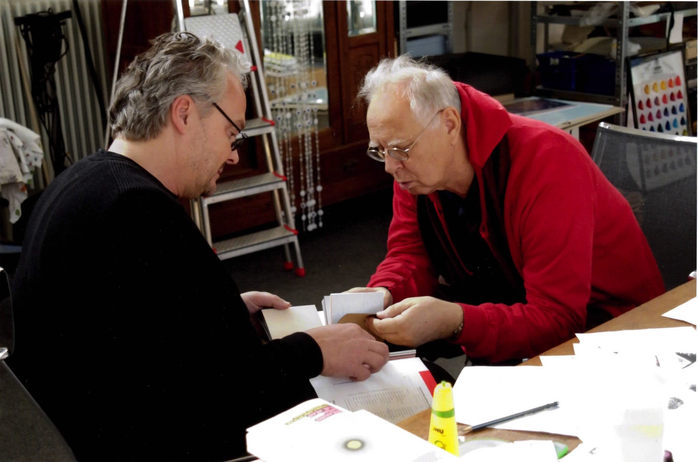 Artist Sigmar Polke and Gallerist Mike Karstens review work related documents and images in studio