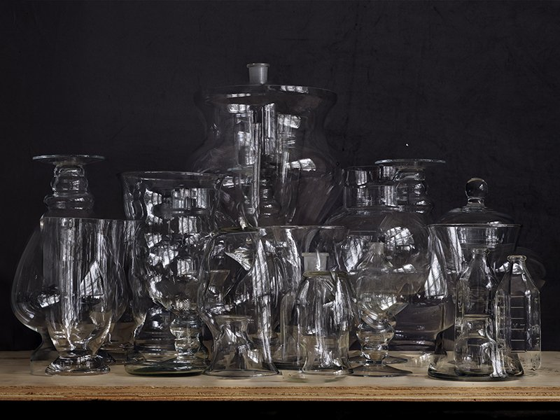 still life image of glassware on a piece of plywood