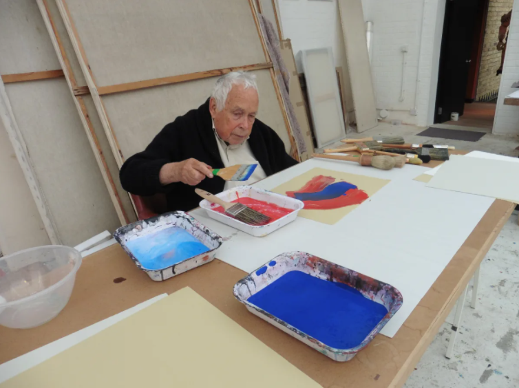 Howard Hodgkin hand-painting Blue Evening in his studio