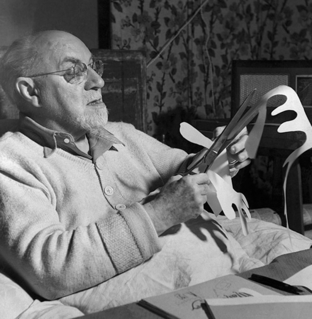 photograph of Henri Matisse working on paper Cut-Outs. Image: via Wikimedia Commons.